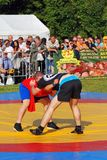 Two women fight on the mat Stock Images