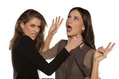 Two women fighting. Two young women having a fight stock photo