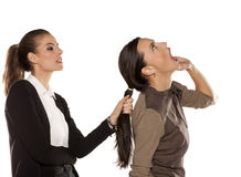 Two women fighting Stock Photos