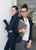 Two women with files Royalty Free Stock Images