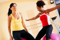 Two women with fitness ball in gym Royalty Free Stock Photos