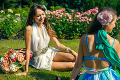Two women in flowers park Royalty Free Stock Images