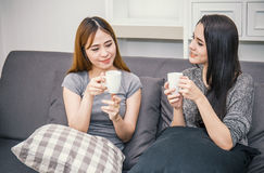 Two women friends having conversation and drinking coffee. Afternoon tea break Stock Photography