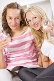 Two women friends at home Royalty Free Stock Photos