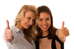 Two women friends isolated over white background showing thumb up Royalty Free Stock Photos