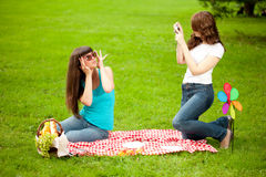 Two women, friends, outdoors  Stock Images