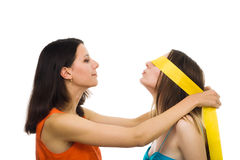Two women friends play with fillet Royalty Free Stock Photography