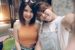 Two women friends selfie. Happy couple take photo together. Beau stock photos