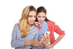 Two women friends taking selfie with smartphone. Royalty Free Stock Photos