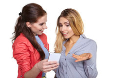 Two women friends taking selfie with smartphone. Stock Photos