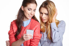 Two women friends taking selfie with smartphone. Stock Images
