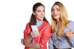 Two women friends taking selfie with smartphone. Royalty Free Stock Photo