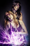 Two women of the future, Twin, future concept, light rays Royalty Free Stock Images