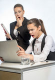 Two women gaze into computer Royalty Free Stock Photo