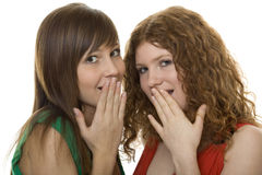 Two women with gestures astonishment. The hand in front of the mouth Stock Photo