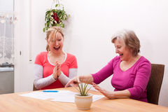 Two women get joyful message Royalty Free Stock Photography