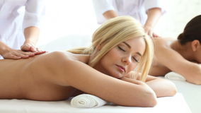 Two women getting massage. In spa salon stock video footage