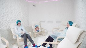 Two women and girl relaxing in a salt cave stock video footage