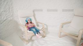 Two women and girl relaxing in a salt cave. At a Halotherapy. Long shot stock footage