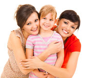 Two women and girl, smiling, hugging each other Royalty Free Stock Photos