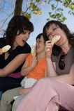 Two women and girl and vanilla ice cream Royalty Free Stock Photo