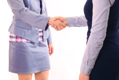Two women give handshake after agreement Stock Photo