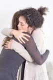 Two women giving a hug Stock Photos