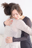 Two women giving a hug Stock Images
