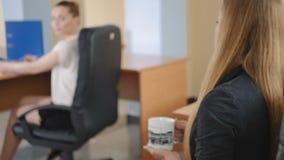 Two women go on a break in the office. stock video