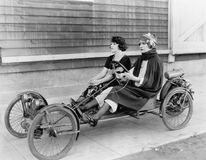 Two women in go kart Stock Images