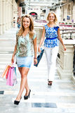 The two women go shopping in a mall Royalty Free Stock Photo