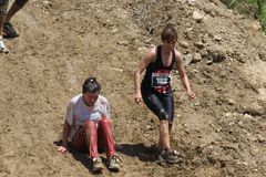 Two women  going down on a steep slope Royalty Free Stock Photography