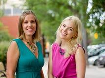 Two women going shopping. Two women walking down street Royalty Free Stock Photo