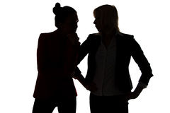 Two women gossip Royalty Free Stock Photo