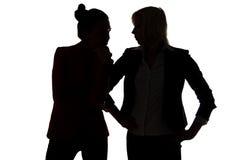 Two women gossip Royalty Free Stock Photo