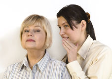 Two women gossiping Stock Photo
