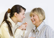 Two women gossiping Royalty Free Stock Photo