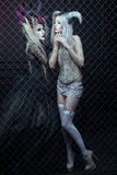 Two women Gothic dresses are closed in a cage. Royalty Free Stock Photo