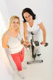 Two women at gym Royalty Free Stock Image