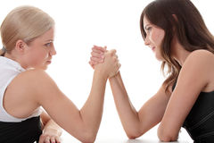 Two women hands fight. Isolated on white background royalty free stock photography
