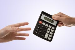Passing the calculator royalty free stock image