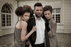 Two women and an handsome guy Stock Photography
