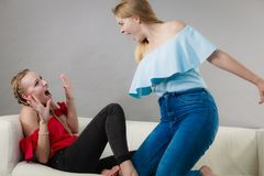 Two women having argue fight. Two young pretty women being mad at each other having argue fight. Friendship rivaly and envy problems Royalty Free Stock Images
