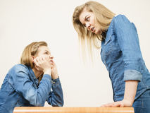 Two women having argue Stock Image
