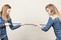 Two women having argue pulling rope. Being mad at each other. Bad rivalry relationship Stock Photography