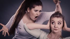 Two women having argue. Fight being mad at each other. Female telling off, ignorance concept Stock Photos