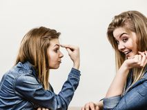 Two women having argue. Mocking up being mad at each other. Female telling off, ignorance concept Royalty Free Stock Photo