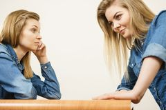Two women having argue. Mocking up being mad at each other. Female telling off, ignorance concept Royalty Free Stock Images