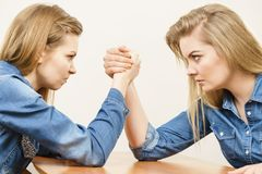 Free Two Women Having Arm Wrestling Fight Stock Photos - 104966883