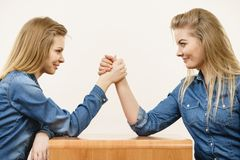 Two women having arm wrestling fight Stock Photography